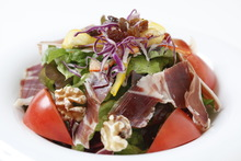 Tomato and raw ham salad
