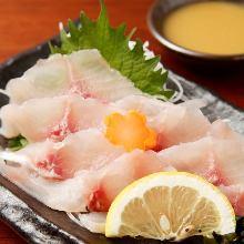 Slices of carp sashimi rinsed in cold water