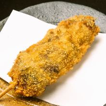 Fried pork, perilla, and cheese skewer