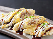 Tonpei-yaki (stir-fried cabbage and meat topped with egg)