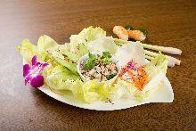 Ground pork and herbs salad lettuce wraps