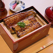 Premium eel served over rice in a lacquered box