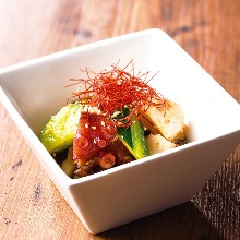 Octopus and cucumber dressed in chili oil