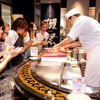 All-you-can-eat sushi and tuna filleting show