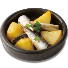 Stone oven baked oil sardine and potatoes