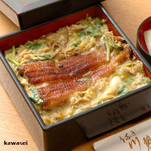 Mini eel served over rice in a lacquered box