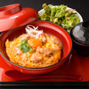 Rice bowl topped with chicken and egg served with chicken dashi soup