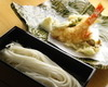 Lunch Cold udon noodles served on a bamboo rack with tempura and 2 kinds of dipping sauce