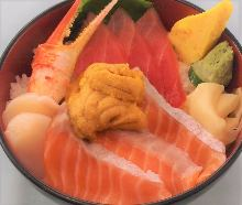 Seafood rice bowl with salmon, chutoro (medium fatty tuna), scallop, crab claw, and sea urchin