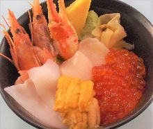 Seafood rice bowl with crab claw, squid, scallop, shrimp, sea urchin, and salmon roe