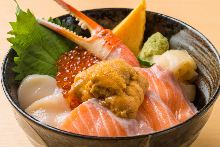 Seafood rice bowl with salmon, crab claw, scallop, sea urchin, and salmon roe