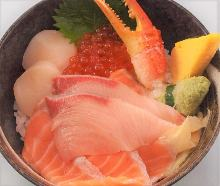 Seafood rice bowl with young yellowtail, salmon, crab claw, scallop, and salmon roe