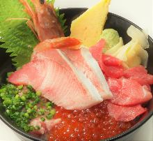Seafood rice bowl with young yellowtail, tuna scrape, shrimp, negitoro, and salmon roe