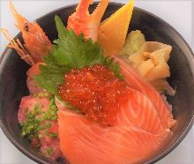 Seafood rice bowl with salmon, shrimp, crab claw, negitoro, and salmon roe