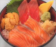 Seafood rice bowl with salmon, chutoro (medium fatty tuna), and sea urchin