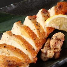 Grilled locally raised chicken breast seasoned with salt and pepper