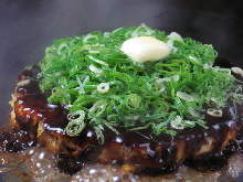 Pork okonomiyaki topped with grilled spring onion and butter