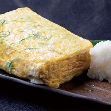 Japanese-style rolled omelet with whitebait and green onion