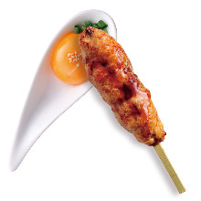 Grilled meatball skewer with egg yolk