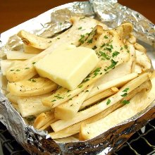 Grilled eringi mushrooms with butter