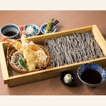 Buckwheat noodles served on a bamboo strainer with shrimp tempura