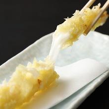Deep-fried mozzarella cheese in broth