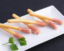 Prosciutto wrapped grissini (breadsticks)