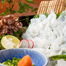 Live octopus thinly sliced sashimi