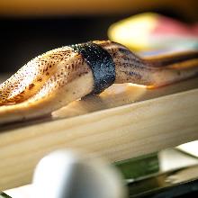 Nigirizushi topped with big-sized conger eel (anago)