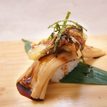 Nigiri (small balls of sushi rice topped with raw fish)