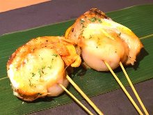 Grilled scallop skewer
