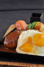 Hamburg steak topped with an egg sunny-side up