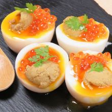 Boiled egg topped with sea urchin and salmon roe
