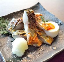 Grilled dried in ashes mackerel