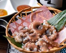 Live octopus sashimi