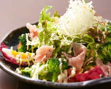 Caesar salad with soft-boiled egg and prosciutto