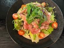 Tomato and raw ham salad