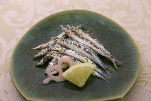 Salted and grilled silver-stripe round herring