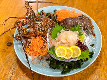 Live spiny lobster sashimi