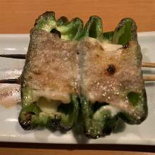 Pork wrapped green pepper and cheese skewer