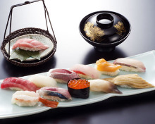 Assorted nigiri sushi (12 kinds) with a seasonal dish served in a bowl