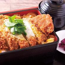 Pork loin cutlet served over rice