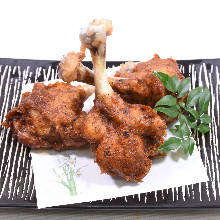 Deep-fried chicken wing drumettes