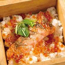 Steamed rice with toppings in wooden steamer