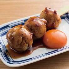 Meatballs served with egg yolk