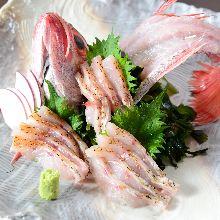 Thinly sliced rosy seabass sashimi