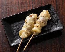Grilled pork-wrapped mochi skewer