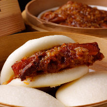 Simmered pork belly with steamed bun