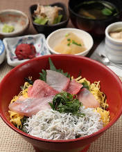 Seafood rice bowl topped with whitebait