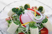 Mizuna salad topped with slow-poached egg